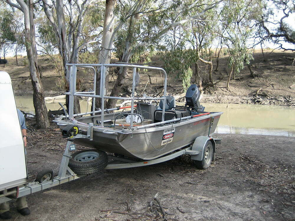 Launching electrofishing boat on Billabong Creek